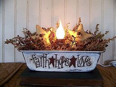 Hey, I found this really awesome Etsy listing at http://www.etsy.com/listing/114659073/primitive-faith-hope-love-bread-pan