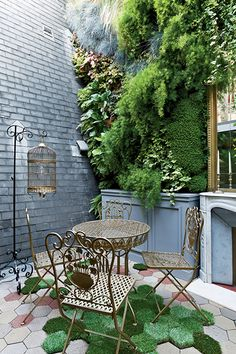 How To Arrange Your Stuff Like An Interior Design Pro #refinery29  http://www.refinery29.com/dwell/15#slide6  This French home masters a bold vignette. Ornate furnishings, a lush vertical garden, and a mirror add character to the home's courtyard.