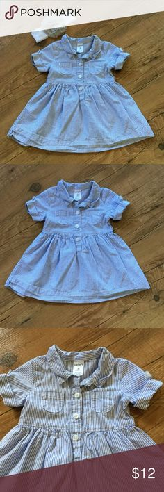Blue and white striped dress Blue and white striped, short sleeve, button up dress. Little pockets on the chest, faux roll up sleeves with button tabs on the arms. Please ask any necessary questions prior to purchasing. No trades. Save even more with a bundle discount! Carter's Dresses Casual
