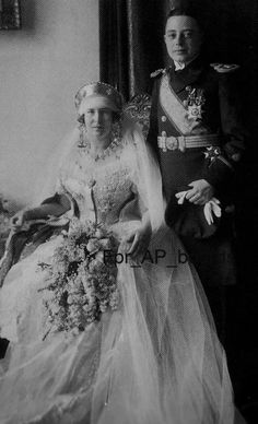 Karl of Leiningen, in his military finery, with his bride, Grand Duchess Marie Kirillovna of Russia, on their wedding day, 25 Nov. 1925.  Marie was a daughter of Grand Duke Kirill, pretender to the czarist throne.  Karl and Marie had 7 children.  In 1946 Karl, who'd been forced to join the German army, died of starvation in a Soviet POW camp.  Marie, grief stricken and nearly broke, died of a heart attack 5 years later.  She was only 44.