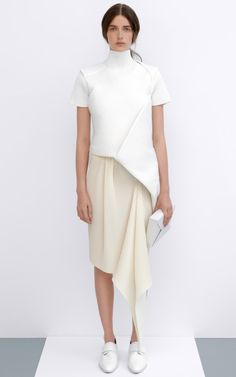 Origami-styled folding and intriguing shapes. J.W. Anderson resort 2014.