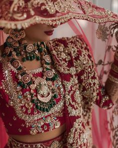 A uniquely designed red lehenga with stunning embelished golden embroidery and blue stones. The gorgeous kundan and stones embedded necklace makes this bridal look OTT! (C) Ushna Khan Photography #wittyvows #indianwedding #indianbride #bridaldetails #bridalaccesories #indianbridaljewellery #indianbridalwear #indianweddingphotography #weddingideas #bridallehenga #redlehenga #kundanjewellery #kundannecklace