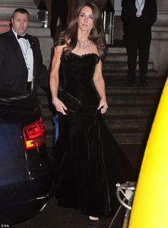 Letting her hair down: The Duchess of Cambridge arrives at the Imperial War Museum in London for the Sun Military Awards in a strapless black velvet dress