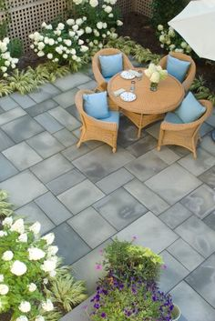 Patio layout- variations of gray, softened green plant borders, geometric pattern