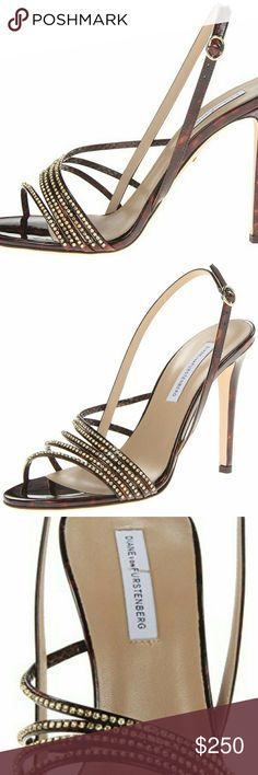 "Diane Von Furstenberg Heels 100% LeatherImportedLeather soleHeel measures approximately 4.25""D'orsay-inspired sandal with rhinestone-studded vamp straps featuring backstrap with buckle closure. Worn once. Like new condition. Diane Von Furstenberg Shoes Heels"