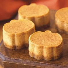 Miniature Pumpkin Cheesecakes with Cinnamon Crust. Definitely NOT waiting for Thanksgiving to make these little guys