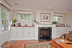 Fireplace and built ins - change top of cabinets to white and stone around fireplace