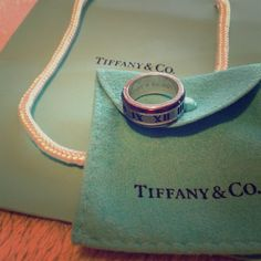 • Tiffany & Co. Atlas ring • Tiffany & Co. Atlas ring. Size is a 6.5, comes with the Tiffany's bag and the ring pouch, I can't find the box at this moment, I know I have it somewhere, just not sure where.. Anyways, the ring needs a good cleaning and has some wear to it, can use a good polishing too.. Sold as is, please ask any questions prior to purchasing. More pictures upon request ❤️ NO TRADES | NO PAYPAL Tiffany & Co. Jewelry Rings