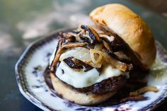 grilled beef and mushroom burger with onions and swiss cheese