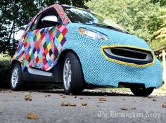 "YARN BOMBING - A Smart Car decorated by ""Yarn bomber"" artist Donna Okoro is shown in Birmingham, Ala."