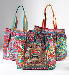 Ari work is a traditional method of embroidery using a long needle, in this case using rich coloured threads to form an intricate floral design. Fairly traded from India by Namaste