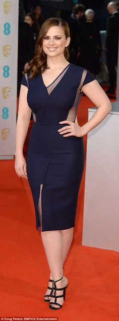 Hayley Atwell showed off her assets as she strutted her stuff in a blue dress wi...