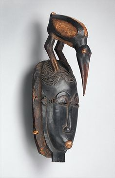 Portrait Face Mask (Mblo) Date: 19th–mid-20th century Geography: Côte d'Ivoire, central Côte d'Ivoire Culture: Baule peoples Medium: Wood, pigment, hemp