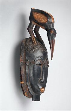 Portrait Face Mask (Mblo) Date: 19th–mid-20th century Geography: Côte d'Ivoire, central Côte d'Ivoire Culture: Baule peoples Medium: Wood, pigment, hemp