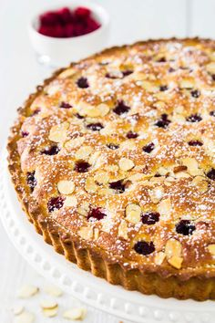 This raspberry almond tart has a soft buttery dough along with a rich almond frangipane filling and a layer of raspberry jam. It's a decadent dessert that will please just about anyone's tastebuds. Almond Tart Recipe, Almond Recipes, Baking Recipes, Frangipane Recipes, Frangipane Tart, Just Desserts, Delicious Desserts, Dessert Recipes, Sweet Pie