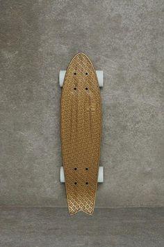 gold coloured longboard
