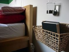 Baskets on the wall next to the bed when there isnt enough room for a nightstand. home-sweet-home