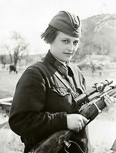Lyudmila Pavlichenko (née Belova) - Sniper 25th Chapaev Rifle Division of the Red Army. Hero of Soviet Union. Holding a Mosin-Nagant sniper rifle with a PEM scope.