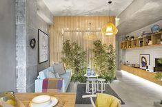 Lemn și beton într-o amenajare industrială a unei garsoniere de 46 m² Jurnal de design interior