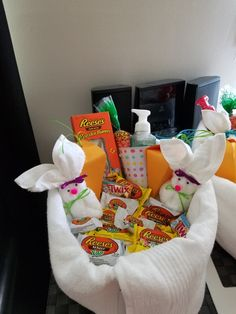 2017 Easter Basket.  There are two bath towels and two wash cloths  with various Reeces candies to fill the towel shaped basket .  Who can't use towels and washcloths when you live on your own?
