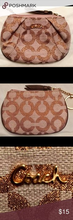 """COACH SIGNATURE CANVAS LEATHER ZIP WALLET Pre owned, used maybe a few times. Great condition. Color is rosy copper Metallic with brown leather trim. Outside open compartment. Top zip closure with leather pull and there's a gold hoop keychain attached to a leather loop inside. Easy access to grab keys. Smoke free home. 5 1/2"""" X 3 1/2"""" Coach Bags Wallets"""
