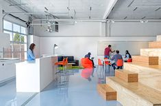 """CHA:COL has completed a """"bare bones"""" office for tech startups that features a shipping container and a wooden bleacher that doubles as a storage unit Ikea Glass Table, Startup Incubator, Space Matters, Shipping Container Design, Startup Office, Container Shop, Room For Improvement, Tiny House Living, Cool Tech"""