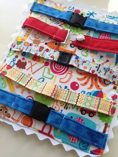 preschool - toddler quiet time buckle toy mat travel waiting room activity buckles-clasps learning toy I spy back YOU CHOOSE buckles on Etsy, $36.00