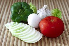 Fresh vegetables on a chopping board by Paweł Chrząszczewski on tookapic