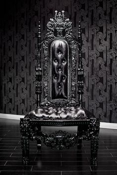 4060 BLACK LACQUER SKULL BAROQUE CHAIR  This incredible chair is intricately hand carved out the highest quality wood and finished in an extraordinary, shiny, black finish. It is then upholstered in a sumptuous black velvet, featuring a tall tufted backrest and studs. It features skulls on the head rest, armrest, below the seat and on the feet. This chair is a piece of art, yet very sturdy and functional. This gorgeous piece will undoubtedly add a touch of glamor and rock and roll to any…