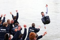 WET WINNER: Oxford University coxswain Oskar Zorrilla was tossed into the River Thames in London Sunday by his rowing teammates after the team won the 159th Oxford vs. Cambridge University Boat Race. (Matthew Childs/Action Images/Zuma Press)