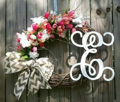 Beautiful 20' Grapevine Wreath with Hydrangeas, monogram and a Chevron bow.  This wreath can be made in a variety of colors.  1) Pick your wreath color. 2) Pick your flowers. (Hydrangeas, Roses,      Sunflowers Cala Lillys etc. 3) Choose your monogram 4) Free Shipping   Custom designed by you and created by Chic Wreaths and Designs!  https://m.facebook.com/chicwreathsdesigns/