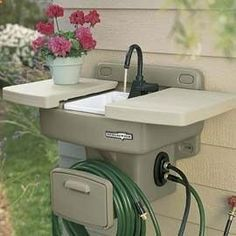 """Water Station Plus Outdoor Sink -- Mounts securely to exterior wall for all grilling, gardening, hand-washing, and everyday clean-up tasks. When the Water Station Plus is closed it functions as a work or storage shelf. Outdoor Fun, Outdoor Spaces, Outdoor Living, Outdoor Ideas, Outdoor Kitchens, Outdoor Camping, Backyard Camping, Outdoor Stuff, Outdoor Projects"