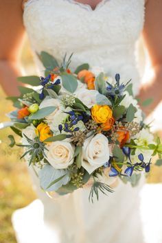 Stunning bouquet! photo by http://www.twilasphotography.com, see more: http://theeverylastdetail.com/orange-cornflower-blue-tennessee-wedding/