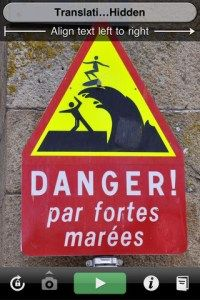 "This (altered) French coastal sign says ""Danger from strong tides."" (Not: ""Danger, falling surfers!"")."