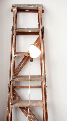 We use an old ladder as a plant holder -- but they're incredibly versatile and add a great look to a room.
