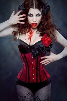 Gore Couture Corsetry: £220.00 Lorena (Underbust) - Shown in blood red silk with a hand sewn overlay of distressed/torn sheer micro-mesh. Has a front busk and an internal skeleton of steel boning for maximum cinch  comfort. - LOVE IT