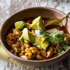 Tons of spice, corn and bell pepper give this healthy one-pot chicken chili recipe Southwestern flair. #SoupsOn