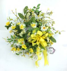 Spring Daisy Wreath in Yellow White & Green with Berries and Bow. Love the wild, untamed look of this wreath. www.southerncharmwreaths.com