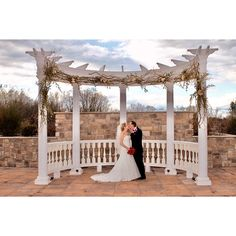 Smooching on the terrace.  Ambassador Video and Photography VideoAndPhotography.com #RidgewoodNJ #bergencounty #bergencountywedding #bergencountyweddingphotographer #arch #trellice #theterraceatbiagios #biagios #theterracenj #paramus #paramusnj #WeddingDress #Tuxedo #kiss #love #wedding #married #husbandandwife #newlyweds #justmarried #catering #cateringhall