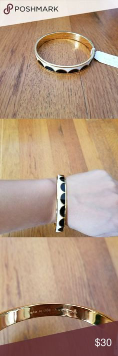 """Kate Spade """"All the trimmings"""" bangle bracelet Kate Spade """"All the trimmings"""" bangle bracelet black and white, with gold trim. kate spade Jewelry Bracelets"""