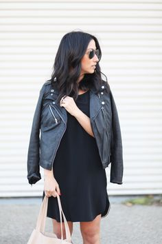 A little black dress goes daytime chic with the addition of a leather moto jacket. Add minimal accessories like your favorite sunglasses and a carryall to complete the look.