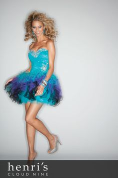 Like floating on a flirty cloud, this teal blue, purple, and black homecoming dress is super short, criss-cross patterned and embellished with a sassy sweetheart neckline and beaded trim on the waist and bodice. The sexy lace up back makes it a dream for twirling 380 degrees on the dance floor. Comes in Tropic, Champagne/Blush and Sunset colors.  Shop www.henris.com  Minerva 1.800.952.3560  Columbus 1.888.823.9880  Homecoming Prom Sorority Formal