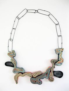 "Yiota Vogli ""Paper Stripes"" Greece, 1958. Necklace - Paper, resin, oxidized copper, oxidized silver."