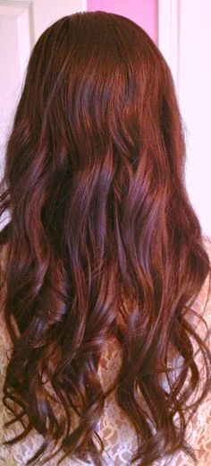 Dark Auburn Hair curled loosely