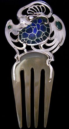 Albert Holbein, German, 1900. A Jugendstil fabulous griffin beast silver comb, having a plique-a-jour body and with its wings set with chrysoprase. A pearl clutched in its beak.