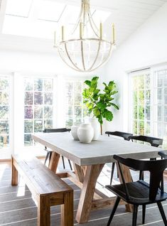 Black wooden chairs at a wood and concrete trestle dining table in a modern farmhouse dining room. Concrete Dining Table, Trestle Dining Tables, Dining Room Table, Dining Chairs, Dining Rooms, Round Wooden Dining Table, Small Dining, Patio Dining, Lounge Chairs