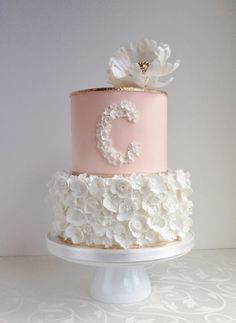 Cute pink and white cake with initial