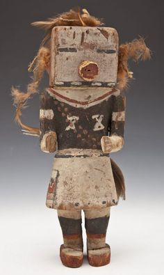 "DESCRIPTION: Hopi hand carved wood kachina doll with polychrome painted decoration and decorated with yarn and feathers. Circa late 19th century. PROVENANCE: Obtained by consignor's father while at school at Arizona University in Flagstaff during the late 1940's. MEASUREMENTS: 12"" high."