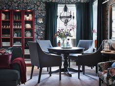 IKEA INGATORP black round extendable table and SAKARIAS dining chairs in both grey and floral patterns support the dining room's vintage floral wallpaper and dark green velvet curtains. Dining Room Colors, Dining Room Sets, Dining Room Design, Living Room Chairs, Dining Room Furniture, Furniture Ideas, Dining Table, Ikea Ingatorp, Funky Living Rooms