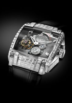 REB-5 Tourbillon Full Diamond. SOLD OUT! The REB-5 features a mechanical tour billion movement and twin mainspring barrels to provide seven days of power.  For more information, please visit: http://www.rebellion-timepieces.com/collection-reb-5-tourbillon-manufacture.php#1
